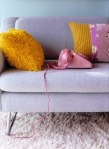 Pink telephone on sofa