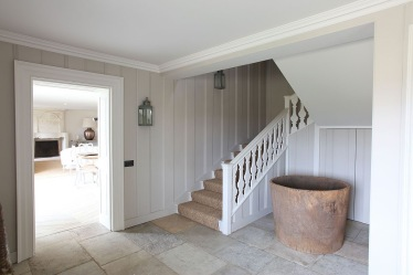 White pannelled halway with Swedish Style staircase, courtesy of Light Locations