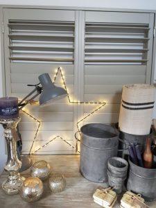 Vintage Barn Interiors star lights and grain sack fabric: Photo; Charis White