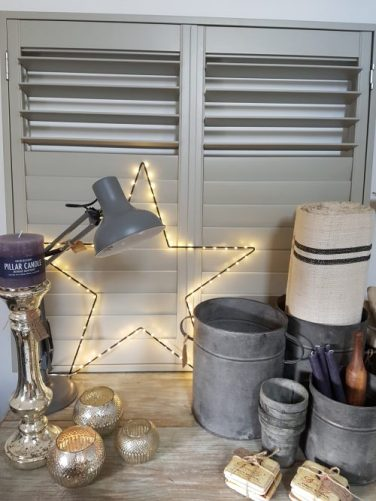 Vintage Barn Interiors star lights and grain sack fabric: Photo; Charis White