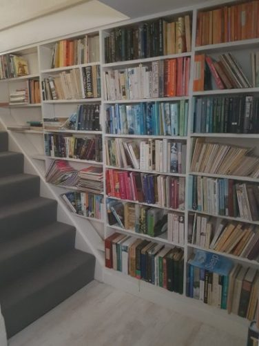 Helen and John Worton's Cornish home. Staircase books. Photo and blog: Charis White