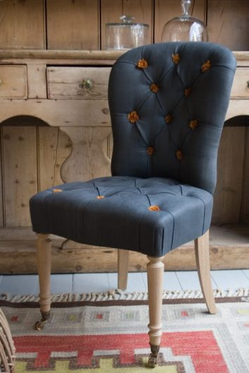 Salon chair in Scottish Graphite linen with orange cotton tassels by Howe London. Marmalade & Slate blog by Charis White