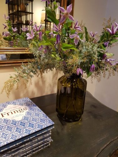 Violet Clematis floral display at Sybil Colefax & John Fowler showroom on Charis White interiors blog