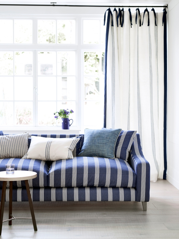 Ian Mankin - Blue living room - Sofa in Oxford Stripe Navy, cushions in Oxford Stripe Mint and Grain Stripe Indigo, curtains in Grain Stripe Union Navy - Portrait