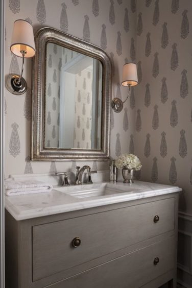 Powder Room with chest of drawers washstand designed by Marcus Design Inc/Pinterest/Charis White interiors blog