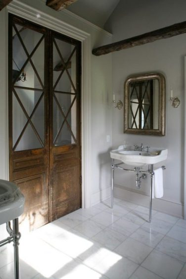 Bathroom with washstand and criss cross wooden door/Pinterest/source unknown?/Charis White interiors blog