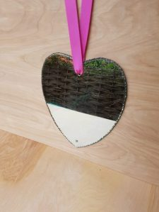 1960s heart shaped wall mirror hanging from ribbon at White Vintage online interiors shop at www.chariswhite.com