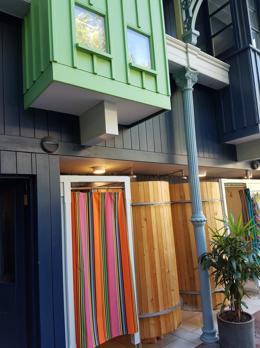 Pool side changing room with stripey curtain at Thames Lido on Charis White Interiors blog