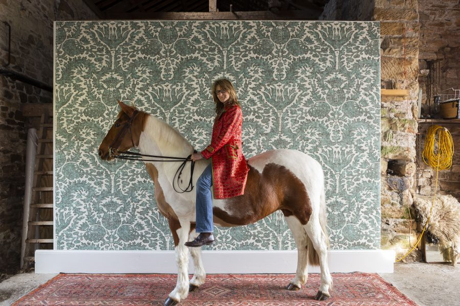 Totty Lowther on her horse with her Pomegranate wallpaper design for Lewis & Wood on Charis White Interiors blog